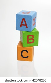 ABC wooden blocks stacked vertically on white background