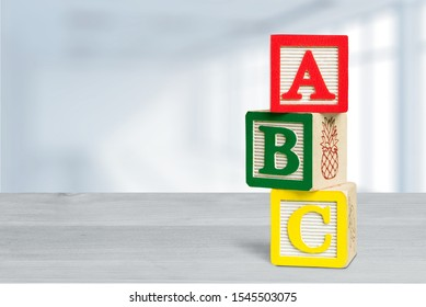 ABC wooden colorful blocks on desk