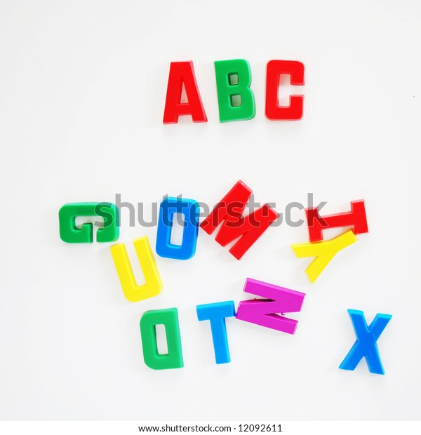 ABC written on fridge door with fridge magnet alphabet letters.