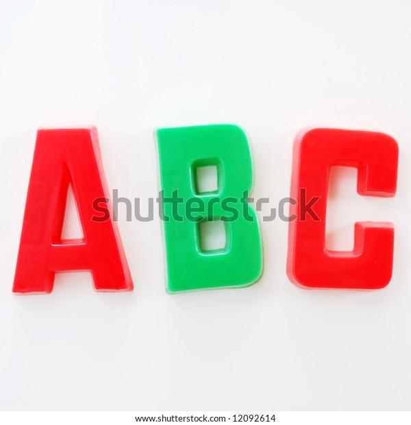 ABC written on fridge door with fridge magnet alphabet letters.