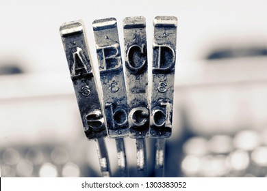 ABCD with old typewriter hammers in monochrome