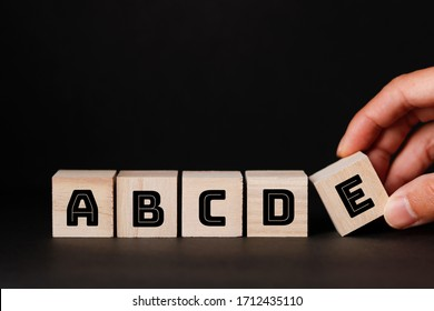 ABCDE wooden blocks and black background