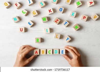 ABCDE wooden blocks and colorful alphabet