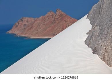 Abd al Kuri island rocks covered with white coral sand - Socotra archipelago, Yemen