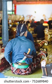 Abdi dalem, servant of Keraton Yogyakarta wear traditional clothes include blangkon and keris