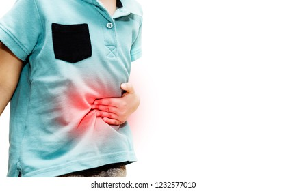 Abdominal pain, health problems. A boy dressed in a blue T-shirt grasps his stomach with his hand, feels a stomach ache. Gastric problems in children. Food poisoning, intestinal problems.