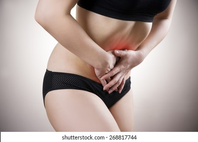 Abdominal pain, heartburn, bloating on gray background. Red dot