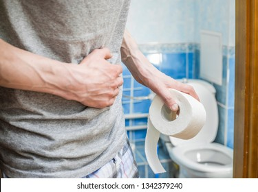 Abdominal pain in a man in the toilet. Diarrhea. Constipation concept.