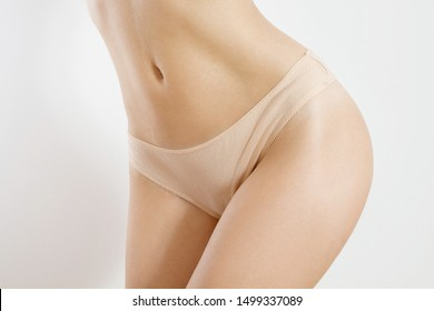 Abdominal press, flat belly. Woman body beauty healthcare. Close up of female body in beige panties with mock up, copy space. Blank template underwear front view. Body spa, bikini hair removal concept