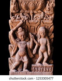 Abduction of Sita - ancient Nepalese wooden carving at the column in palace on Durbar square in Patan, Kathmandu valley, Nepal