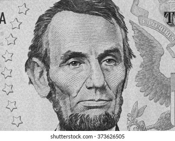 Abe Lincoln face on us five dollar bill close up macro, 5 usd, united states money closeup