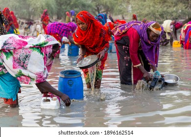 Abeche, Chad - 2 July 2018: Chad women are taking dirty water for a drink and use for daily life