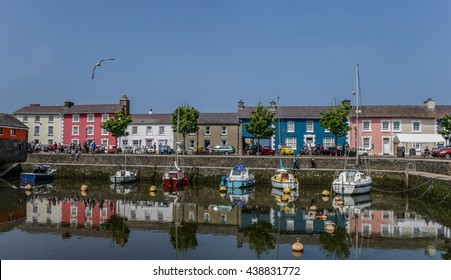 Aberaeron, UK - May 29, 2016: Visitors and local residents enjoy a sunny weekend in the pretty seaside town of Aberaeron, Wales.