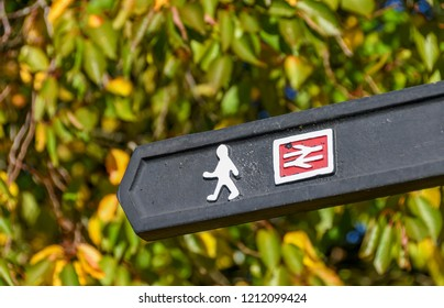 ABERDARE, WALES - OCTOBER 2018: Close up view of a sign in the centre of Aberdare directing rail passengers to a walking route to the town's railway station