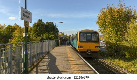 ABERDARE, WALES - OCTOBER 2018: Commuter train at the single platform on the railway station in Aberdare.