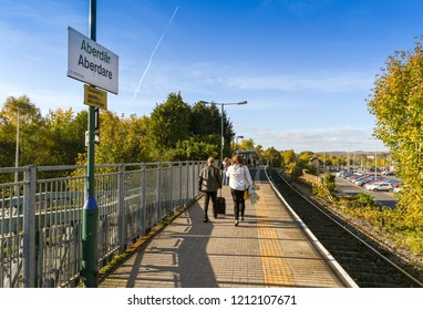 ABERDARE, WALES - OCTOBER 2018: Commuters wallking along the single platform on the railway station in Aberdare.