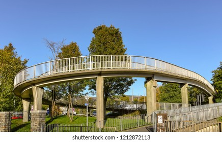 ABERDARE, WALES - OCTOBER 2018: Large circular ramp which takes pedestrians onto a bridge which crosses the main road through Aberdare town centre.