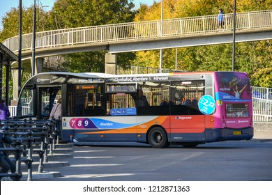 ABERDARE, WALES - OCTOBER 2018: Person catching a bus operated by Stagecoach Group plc in the bus station in Aberdare town centre.