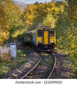 "ABERDARE, WALES - OCTOBER 2018: ""Scenic view of a diesel commuter train approaching the railway station in Aberdare. The line is currently single track."