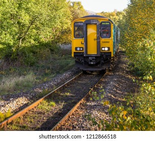 "ABERDARE, WALES - OCTOBER 2018: ""Sprinter"" diesel commuter train approaching the railway station in Aberdare. The line is currently single track."
