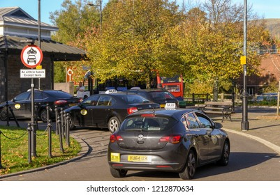 ABERDARE, WALES - OCTOBER 2018: Taxis queuing at the bus station in Aberdare town centre.