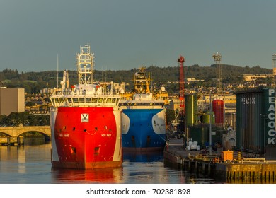Aberdeen harbour, Scotland, United Kingdom, 16th August 2017. Aberdeen harbour and city at dawn with oil tanks and tugs.
