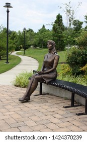 Aberdeen, Maryland, United States - June 14, 2019: Bronze Statue, designed by Will Hemsley, in honor of Gold Star Mothers and Families, located at the 'Fallen Star' Memorial