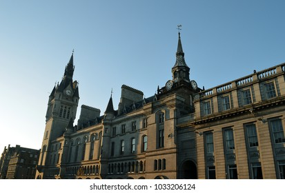 ABERDEEN, SCOTLAND - 12 FEBRUARY 2018: Early evening sunshine turns the grey granite of the Townhouse, Sheriff Courthouse, entrance to Lodge Walk and Tolbooth golden.