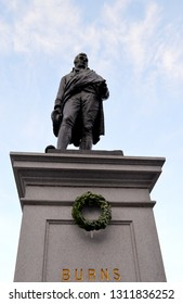 ABERDEEN, SCOTLAND - 24 JANUARY 2019: Henry Bain Smith's statue of Robert Burns, Scotland's National Bard, and mountain daisy in Union Terrace adorned with a wreath for Burns's birthday the next day.