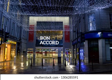 ABERDEEN, SCOTLAND - 25 JANUARY 2019: The Bon Accord Centre, the city's second-largest shopping mall opened in 1985, stands in Upperkirkgate on a rainy winter's night.