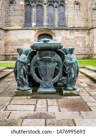 Aberdeen, Scotland, 27/04/2019. Sculptures on a tomb found in front of King's College Chapel in Old Aberdeen