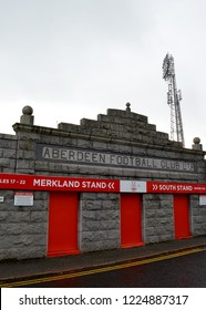 ABERDEEN, SCOTLAND - 31 OCTOBER 2018: Merkland Road entrance to Pittodrie Stadium. In the background, a floodlight from first floodlit ground in Britain.