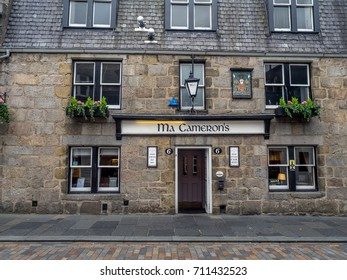 ABERDEEN, SCOTLAND: JULY 24: Exterior facade of the Ma Cameron's pub in the evening on  July 24, 2017 in Aberdeen, Scotland. Ma Cameron's  is a popular Aberdeen watering hole.