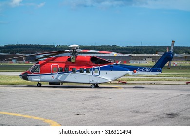 ABERDEEN, SCOTLAND - SEPTEMBER 14 2015: Helicopter getting ready to take off at the heliport