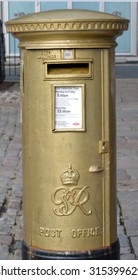 ABERDEEN, SCOTLAND - SEPTEMBER 2015: Postbox painted gold by Royal Mail to commemorate Katherine Grainger's gold medal in the Women's double sculls in the London Olympics, 2012.