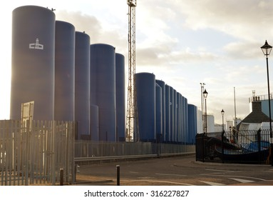 ABERDEEN, SCOTLAND - SEPTEMBER 2015: Reservoir silos operated by Cebo UK Ltd stand at Aberdeen Harbour holding drilling fluids for the North Sea oil and gas industry.