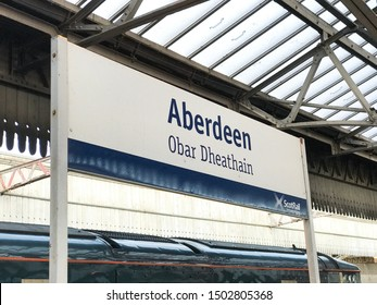 Aberdeen, Scotland, UK - September 12, 2019 : Aberdeen train station sign, reads also Obar Dheathain which is the name of the city in the Scottish Gaelic language.
