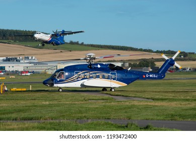 ABERDEEN / SCOTLAND, UK - SEPTEMBER 2018 Babcock Mission Critical Services Offshore, Sikorsky S-92A, cn 92-0297, giving way to a departing Eastern Airways ATR-72.