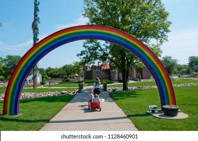 Aberdeen, South Dakota, USA - 7/2018: Storybook Land, under the rainbow walkway