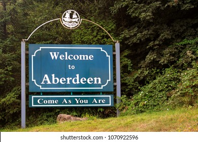 """Aberdeen, Washington/USA - 08 21 2011: Welcome sign of Aberdeen, Washington with the text """"Come As You Are"""" (song by the band """"Nirvana""""). Tribute to Kurt Cobain as Aberdeen is his birthplace."""
