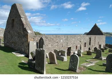 Aberdeenshire, Scotland: August 14th 2018 - Ancient ruined church of St John on clifftop above Gardenstown, Aberdeenshire, Scotland.