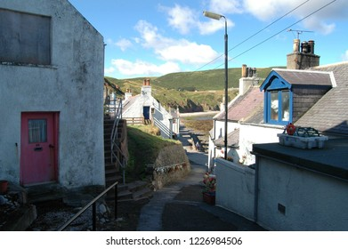 Aberdeenshire, Scotland - August 28th 2018: A lane weaves its way through traditional cottages in Gardenstown, Scotland
