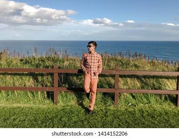 ABERDEENSHIRE, SCOTLAND - MAY 2019 : A man standing at Dunnottar Castle. Stonehaven, Aberdeenshire, Scotland, United Kingdom.