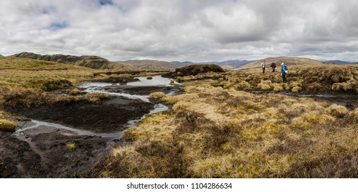ABERFELDY, SCOTLAND - 22 APRIL: three women ascend Meall Corranaich on April 22, 2017 near Aberfeldy, Scotland. Meall Corranaich is one of the 282 Munros (hills over 3,000ft) in Scotland.