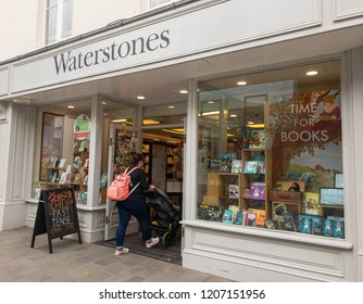 ABERGAVENNY, MONMOUTHSHIRE, WALES - OCTOBER 2018: Exterior view of the Waterstones store in Abergavenny town centre, with a person entering.