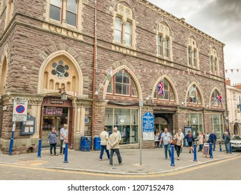 ABERGAVENNY, MONMOUTHSHIRE, WALES - OCTOBER 2018: Wide angle view of the exterior of the market hall building in Abergavenny town centre.
