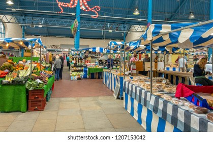 ABERGAVENNY, MONMOUTHSHIRE, WALES - OCTOBER 2018: Wide angle view of stalls in the indoor market hall in Abergavenny town centre.