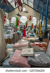 ABERGAVENNY, MONMOUTHSHIRE, WALES - OCTOBER 2018: Close up view of a bedding stall in the indoor market hall in Abergavenny town centre.