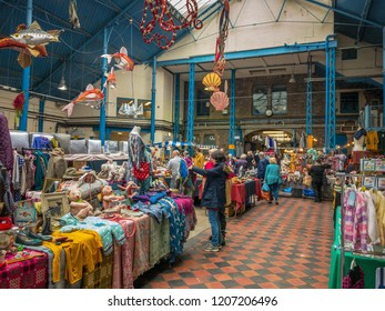 ABERGAVENNY, MONMOUTHSHIRE, WALES - OCTOBER 2018: Shoppers in the indoor market hall in Abergavenny town centre.