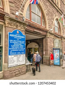 ABERGAVENNY, MONMOUTHSHIRE, WALES - OCTOBER 2018: People entering the market hall building in Abergavenny town centre.